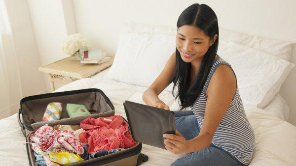 woman preparing baggage