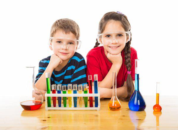 two kids doing science project