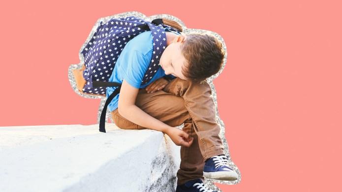 Grade school boy with backpack