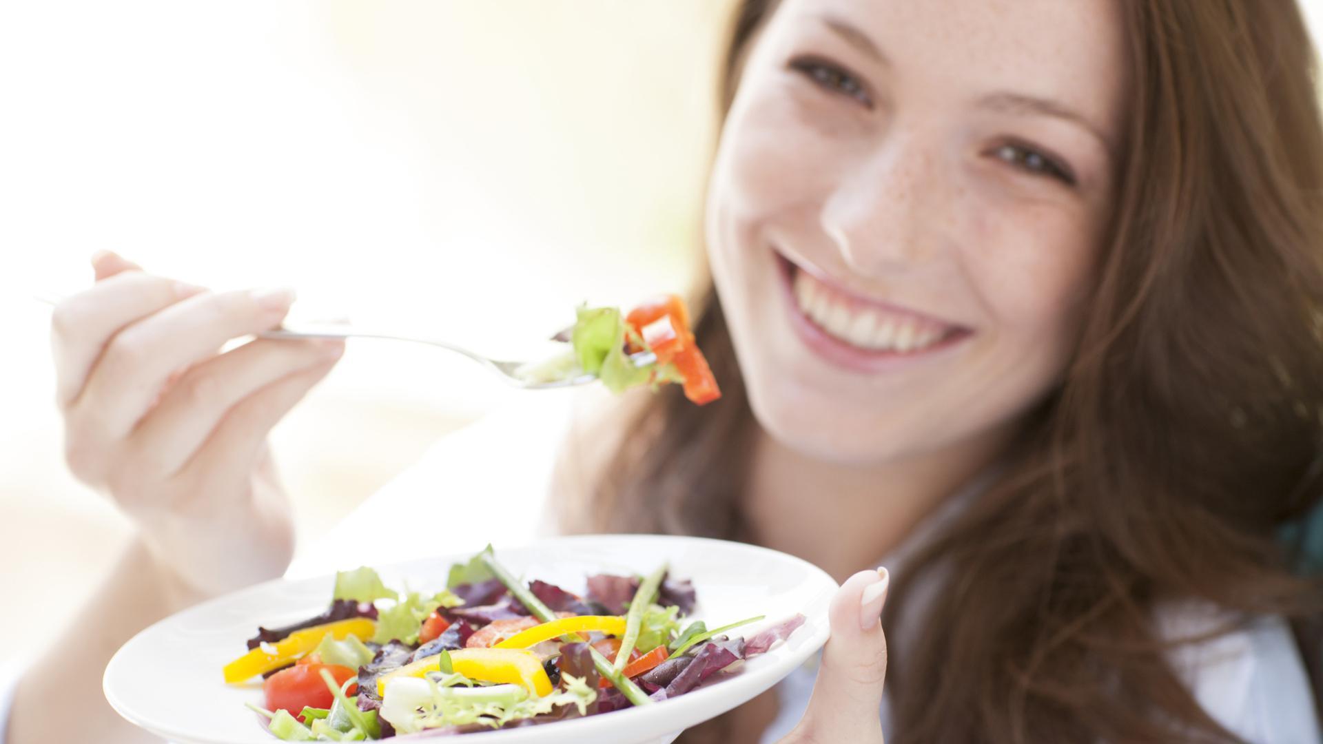 woman eating veggies