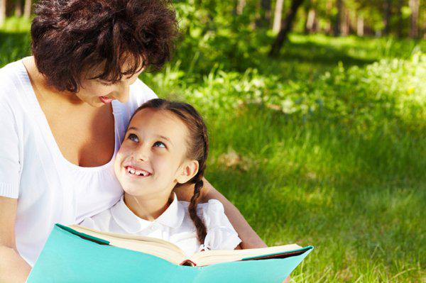 mother reading with kid