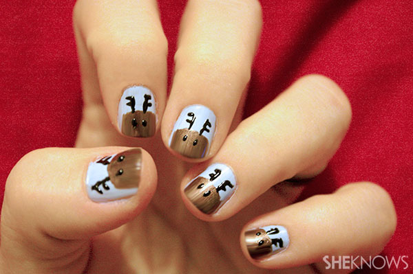 Rudolph nail art tutorial Step 4 draw eyes with toothpick
