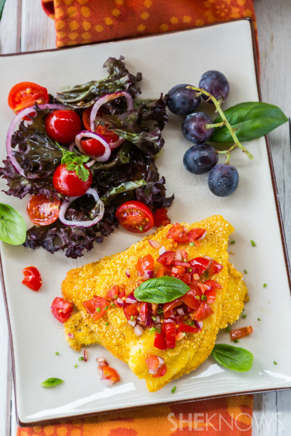 Polenta-crusted fish fillet with tomato salad