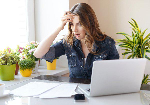 woman at pc with financial problems