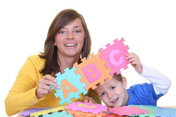 mother and son playing with letters