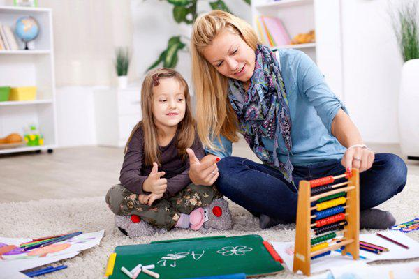mother doing math with daughter