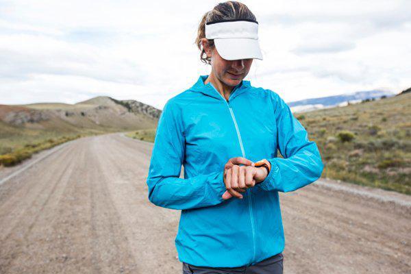 female runner checking time