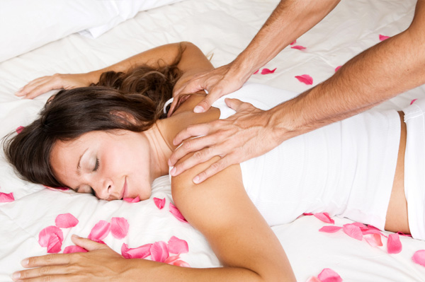Man giving woman massage