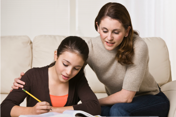 Mother helping teen study