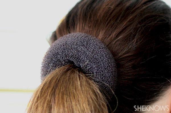 Ballerina bun braid tutorial Step 2 thread hair through doughnut