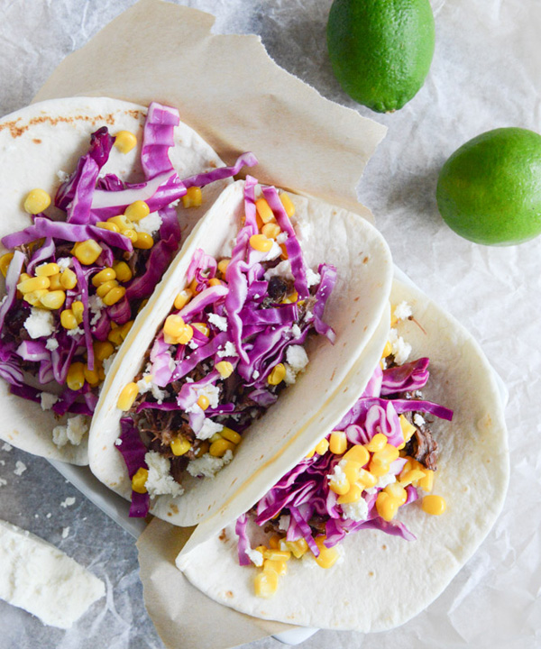 Smoky brisket tacos with shredded cabbage and sweet corn