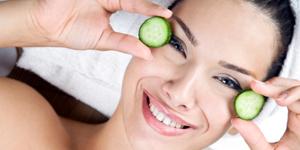 Woman wearing cucumber eye mask