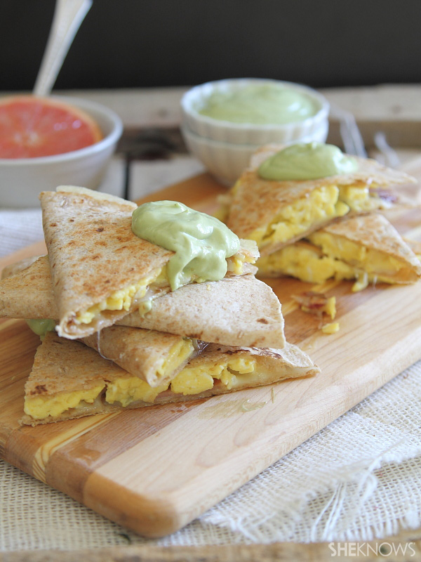 Bacon egg and cheese quesadilla stacks with avocado hollandaise sauce