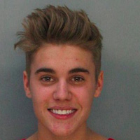 Justin's all smiles in his mug shot!