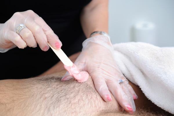 Man having pubic area waxed