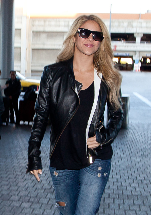 Shakira with long hair, wearing leather jacket