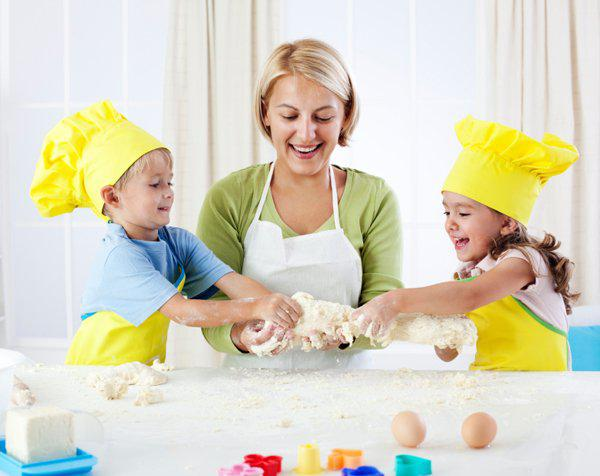 mother playing with kids in the kitchen