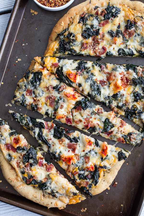 Brown butter lobster and spinach pizza with bacon and fontina
