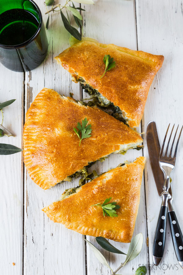Cheesy calzone with kale and spinach recipe