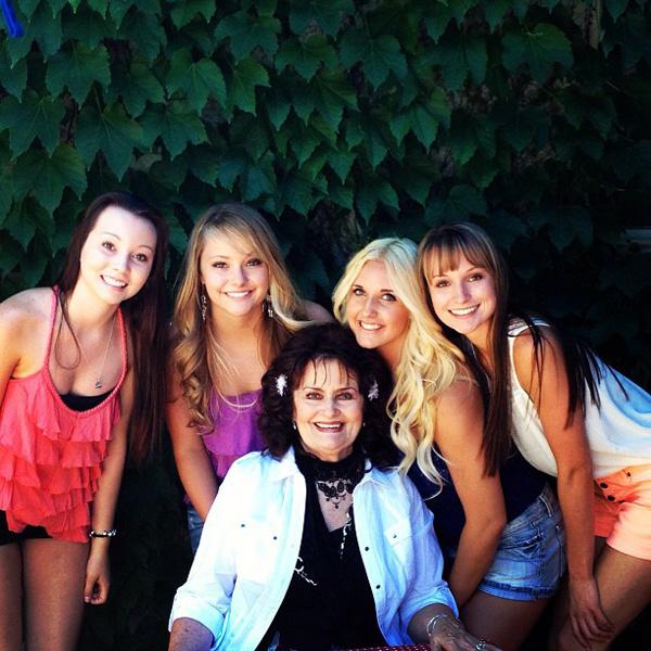 Author Sherri Mills with granddaughters Braidy, Hailey, Hanna and Maegan
