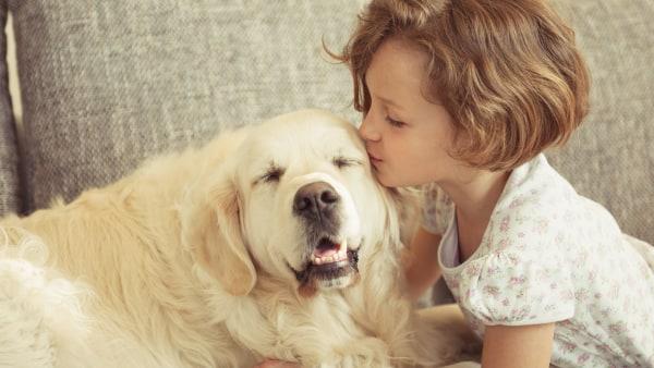 Girl kissing pet dog | Sheknows.ca