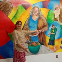 Woman presenting mural