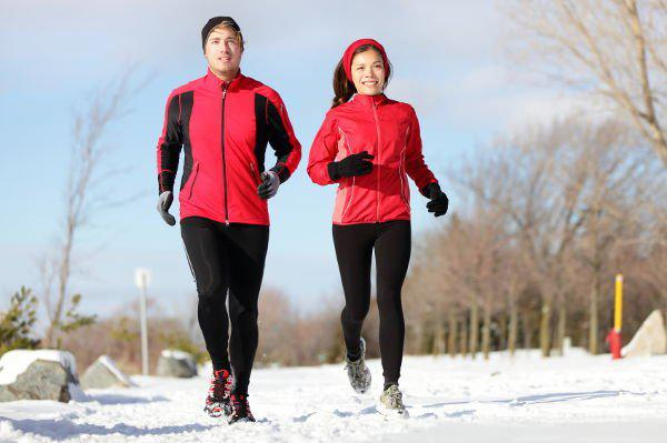woman and men running during winter