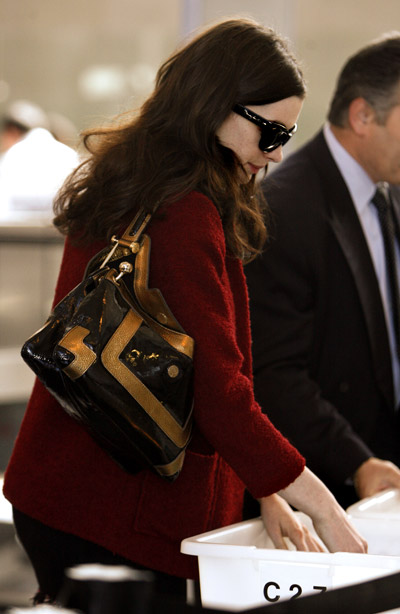 at the airport - Anne Hathaway