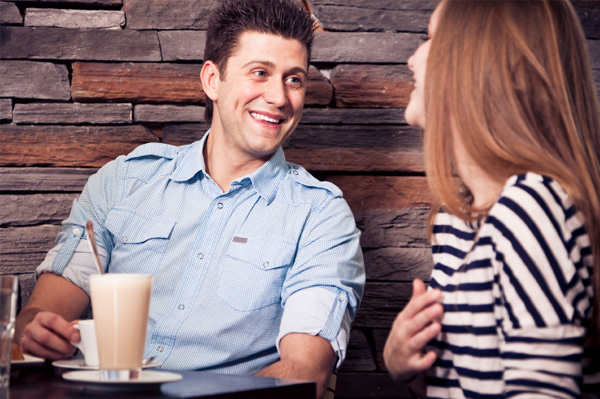 Couple flirting at coffee shop