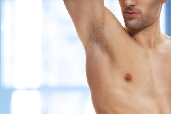 Man looking at armpit