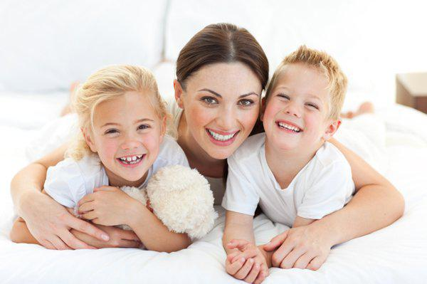 happy mother with son and daughter