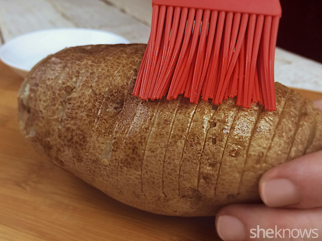 brushing a potato with oil
