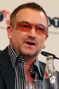 Bono speaking at press conference