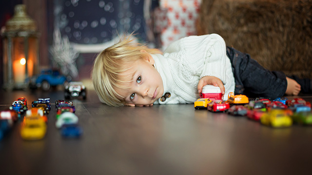 Boy Playing with cars and trucks