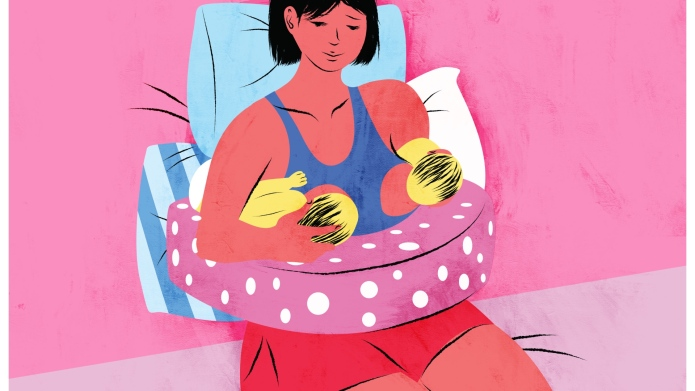 Woman breastfeeding with pillow