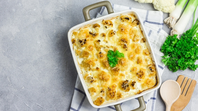 Chicken cauliflower casserole with ingredients on