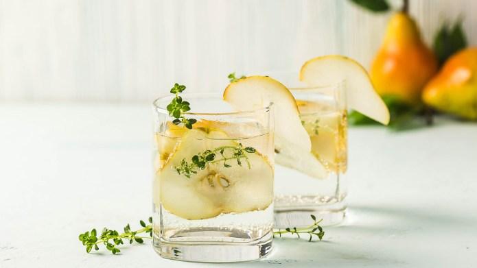 Festive summer drinks, pear thyme cocktail.