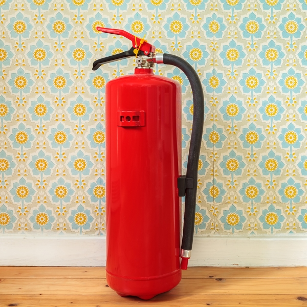 A red multipurpose fire extinguisher