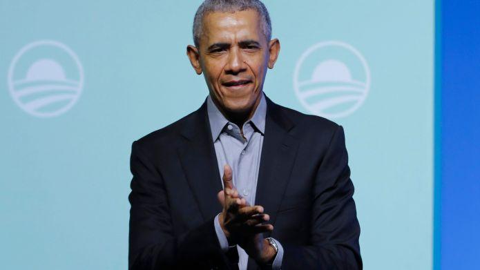 Former U.S. President Barack Obama claps