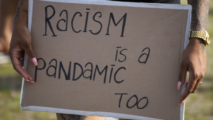 Woman holds a placard as she