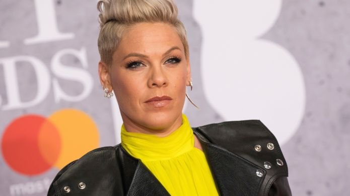Singer Pink poses for photographers upon