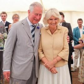 prince Charles arm around duchess camilla