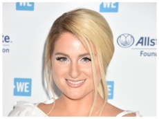 Why Meghan Trainor Is Lying 'Upside Down on My Couch Every Day' Waiting for Her Baby