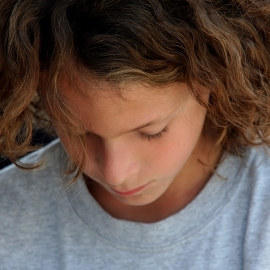 boy with long curly hair
