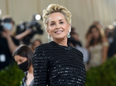 Sharon Stone Posed in a Slinky Black Bathing Suit For This Red-Hot Reminder to Prioritize Self-Care